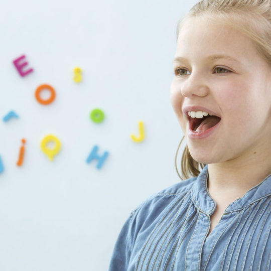 Girl in speech therapy office